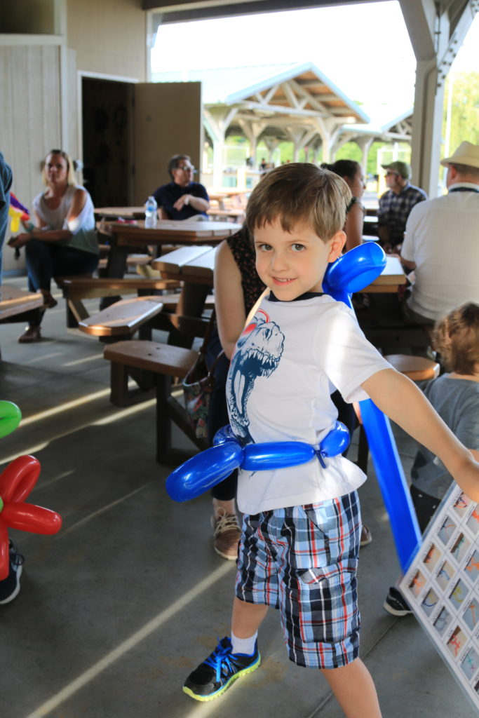 BQMI Team Picnic 15 June 2018 participant enjoying his Magic Mike the Magician balloon sword.