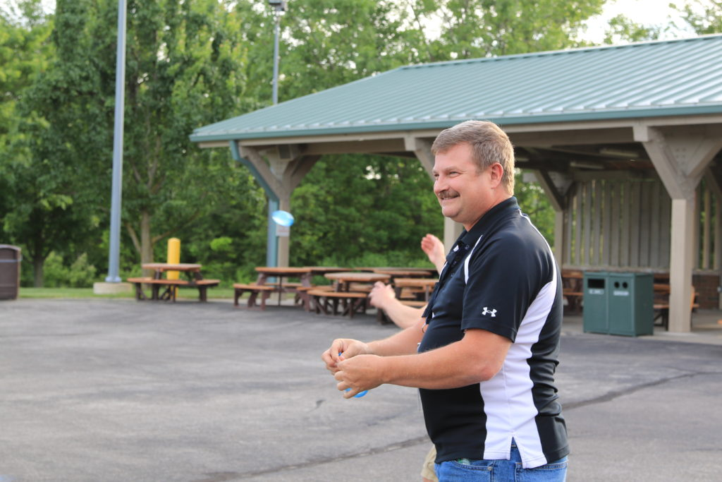 Photograph of BQMI Team Picnic Participants 15 June 2018. Water Balloon in Ron Harvey's hands.