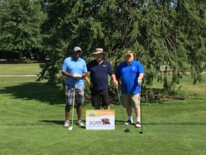 BQMI employees Ron Harvey, John Brinkman, Mike Harper played golf in the Lewis Little Folks charity event on July 13, 2018