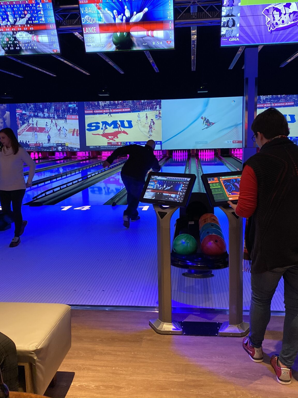 Person bowling at Team BQMI Holiday Gathering